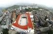 La scuola elementare con la pista d'atletica sul tetto in Cina (Lycs Architecture)